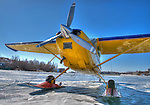 Cessna 180 on the ice in Yellowknife Bay