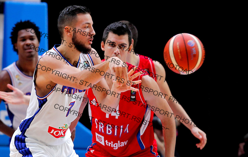 France's Joffrey Lauvergne (L) vies with Serbia's Zoran Erceg  (R) during European championship basketball match for third place between France and Serbia on September 20, 2015 in Lille, France  (credit image & photo: Pedja Milosavljevic / STARSPORT)