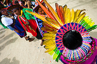 """Natives of the Kamentsá and Inga tribes, wearing colorful headgears, take part in the Carnival of Forgiveness, a traditional indigenous celebration in Sibundoy, Colombia, 12 February 2013. Clestrinye (""""Carnaval del Perdón"""") is a ritual ceremony kept for centuries in the Valley of Sibundoy in Putumayo (the Amazonian department of Colombia), a home to two closely allied indigenous groups, the Inga and Kamentsá. Although the festival has indigenous origins, the Catholic religion elements have been introduced and merged with the shamanistic tradition. Celebrating annually the collaboration, peace and unity between tribes, they believe that anyone who offended anyone may ask for forgiveness this day and all of them should grant pardons."""