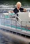 SOUTHBURY CT. 04 July 2015-070415SV01-Lynn Knapp of Sandy Hook takes the helm while launching her boat at the Lake Zoar boat launch in Southbury Saturday.<br /> Steven Valenti Republican-American