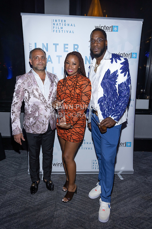 (Left to right) Elie Balleh, Melissa Jackson and musician attend the 10th Annual Winter Film Awards International Film Festival Gala on October 2, 2021 at 230 Fift Avenue in New York City.