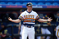 Canisius College Golden Griffins assistant coach Matt Mazurek (12) questions a call during the second game of a doubleheader against the Michigan Wolverines on February 20, 2016 at Tradition Field in St. Lucie, Florida.  Michigan defeated Canisius 3-0.  (Mike Janes/Four Seam Images)