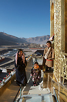 A Tibetan family at Labrang (Chinese Name - Xiahe) Monastery on the Qinghai-Tibetan Plateau. China.