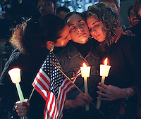 Friends Gina Mavuro, Angie Gonzalez and Amy Jackson at candlelight vigil at Bellevue Hospital.  They do not know any WTC victims, but lit candles to support the families..1