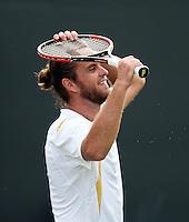 29-06-12, England, London, Tennis , Wimbledon, Xavier Malisse defeats  Fernabdo Verdasco