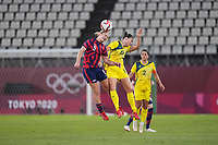 KASHIMA, JAPAN - AUGUST 5: Lindsey Horan #9 of the United States goes up for a header with Emily Gielnik #15 of Australia during a game between Australia and USWNT at Kashima Soccer Stadium on August 5, 2021 in Kashima, Japan.