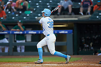 Ashton McGee (36) of the North Carolina Tar Heels follows through on his swing against the Miami Hurricanes in the second semifinal of the 2017 ACC Baseball Championship at Louisville Slugger Field on May 27, 2017 in Louisville, Kentucky. The Tar Heels defeated the Hurricanes 12-4. (Brian Westerholt/Four Seam Images)