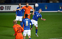 Netherlands's Daley Blind, left, and Italy's Nicolo' Barella jump for the ball during the UEFA Nations League football match between Italy and Netherlands at Bergamo's Atleti Azzurri d'Italia stadium, October 14, 2020.<br /> UPDATE IMAGES PRESS/Isabella Bonotto
