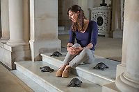 BNPS.co.uk (01202) 558833<br /> Pic: NT/JamesDobson/BNPS<br /> <br /> Property curator Elena Greer in the entrance hall at Kingston Lacy, Dorset with the four recovered bronze tortoises.<br /> <br /> Slow and steady wins the race...<br /> <br /> A set of bronze tortoises stolen from a country mansion have finally been returned... 29 years later.<br /> <br /> The bronze sculptures based on the wealthy 19th century owner's pet were stolen from Kingston Lacy in Dorset in 1992 and reported to the police but never found until a savvy historian spotted one up for auction recently.<br /> <br /> Following the trail, the National Trust traced the tortoise to an antiques dealer, who had acquired the set from a scrap metal dealer, completely unaware of their history.<br /> <br /> The four missing sculptures have finally been returned to Kingston Lacy and gone on display.