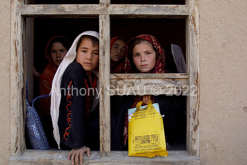 Nawabad, Northern Afghanistan October 2001<br /> <br /> School girls who pack their school books in USA food packaged air drops in the Nawabad refugee camp.