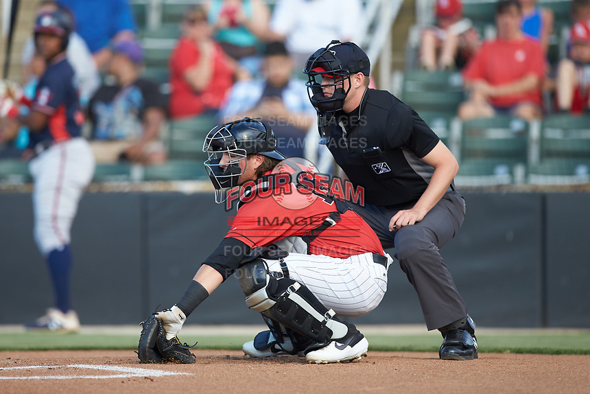 Kannapolis Intimidators catcher Michael Hickman (16) reaches for a pitch in the dirt as home plate umpire Sean Cassidy looks on during the game against the Rome Braves at Kannapolis Intimidators Stadium on July 3, 2019 in Kannapolis, North Carolina.  The Braves defeated the Intimidators 13-11, (Brian Westerholt/Four Seam Images)