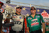 Sept. 5, 2011; Claremont, IN, USA: NHRA funny car driver Mike Neff (left) celebrates with team owner John Force after winning the US Nationals at Lucas Oil Raceway. Mandatory Credit: Mark J. Rebilas-