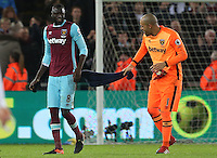 Darren Randolph of West Ham United whips team mate Cheikhou Kouyate with a towel as they leave the field in high spirits after the final whistle of the Premier League match between Swansea City and West Ham United at The Liberty Stadium, Swansea, Wales, UK. 26 December 2016