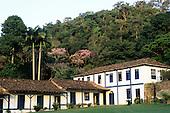 Rio de Janeiro State, Brazil. Fazenda Ponte Alta hotel; white and blue colonial buildings of the hotel.