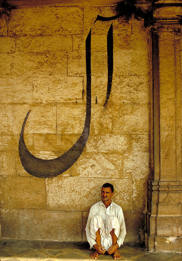 A man rests outside a Temple in Ahmadabad, India. Ahmadabad is the capital of Gujarat state, NW India, on the Sabarmati River. Srinagar, India Kashmir.
