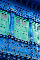An enclosed terrace at one side of the inner courtyard is shielded by green-painted shutters