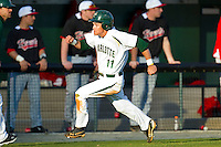 Matt Creech (11) of the Charlotte 49ers hustles down the third base line to score a run against the Delaware State Hornets at Robert and Mariam Hayes Stadium on February 15, 2013 in Charlotte, North Carolina.  The 49ers defeated the Hornets 13-7.  (Brian Westerholt/Four Seam Images)