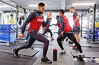 (L-R) Kenji Gorre and Wayne Routledge exercise in the gym during the Swansea City Training at The Fairwood Training Ground, Swansea, Wales, UK. Thursday 15 February 2018
