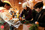 Woodbury, CT- 30 November 2013-113013CM08-  Amber McDonald, left, Environmental Educator at Flanders Nature Center, helps Molly Miller, of Woodbury shape a wreath during a workshop inside the sugar shack at Flanders Nature Center in Woodbury Saturday afternoon. Looking on is Joey Pelletier, 8, of Bethlehem.  The wreaths were made with items found around the wooded area at the center.  The event, open to all ages will continue Sunday from 1 p.m. to 3 p.m. and December 7th and 8th from 1 p.m. to 3 p.m.  To register call 203-263-371. There will also be an artisans market held at the center's studio at the corner of Flanders and Church Hill Road.  The market features hand made items, skin care products, wood building kits and more.  The market will be open Saturday and Sunday from 11 a.m. until 4 p.m. through December 21.  Christopher Massa Republican-American