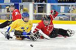 Marc Dorion, Vancouver 2010 - Para Ice Hockey // Para-hockey sure glace.<br /> Team Canada plays against Sweden in Para Ice Hockey action // Équipe Canada joue contre la Suède dans un match de para-hockey sur glace. 14/03/2010.
