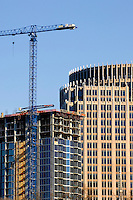 A crane sits ready to help during construction of one of Charlotte, NC's, newest high rise buildings.