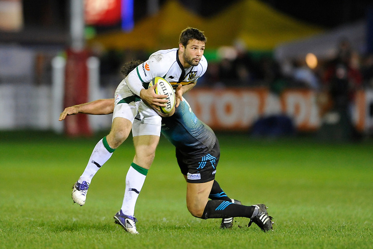 Ben Foden of Northampton Saints (right) is tackled by Sonny Parker of Ospreys during the LV= Cup second round match between Ospreys and Northampton Saints at Riverside Hardware Brewery Field, Bridgend (Photo by Rob Munro)