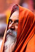 Portrait of a devotee man with an intense gaze, during Holi in Sri Radha Vallabh Lal temple, in Vrindavan, near Mathura Uttar Pradesh, India