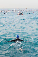 A triathlete swims after the pack at Ironman France 2012, Nice, France, 24 June 2012