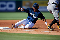 Lakeland Flying Tigers second baseman Anthony Pereira (9) slides into third base during the first game of a doubleheader against the Bradenton Marauders on April 11, 2018 at Publix Field at Joker Marchant Stadium in Lakeland, Florida.  Lakeland defeated Bradenton 5-4.  (Mike Janes/Four Seam Images)