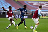 21st March 2021; London Stadium, London, England; English Premier League Football, West Ham United versus Arsenal; Michail Antonio of West Ham United challenges Bukayo Saka of Arsenal