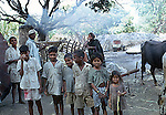 POOR INDIAN CHILDREN in RURAL  VILLAGE POSE for PHOTO