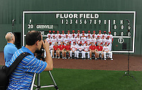 The Greenville Drive's staff photographer, Darrell Snow, gets ready to take the team photo during the team's media day on April 4, 2012, at Fluor Field at the West End in Greenville, South Carolina. (Tom Priddy/Four Seam Images)