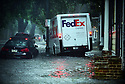 A FedEx truck drives on the sidewalk in the French Quarter to get around stalled cars after heavy rain flooded streets and businesses ahead of Tropical Depression Barry, which is expected to make landfall as a Category 1 hurricane on Sat., in New Orleans, Wed., July, 10, 2019.