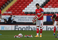 Jake Forster-Caskey of Charlton Athletic lays a wreath in the center of the pitch during Charlton Athletic vs Plymouth Argyle, Emirates FA Cup Football at The Valley on 7th November 2020