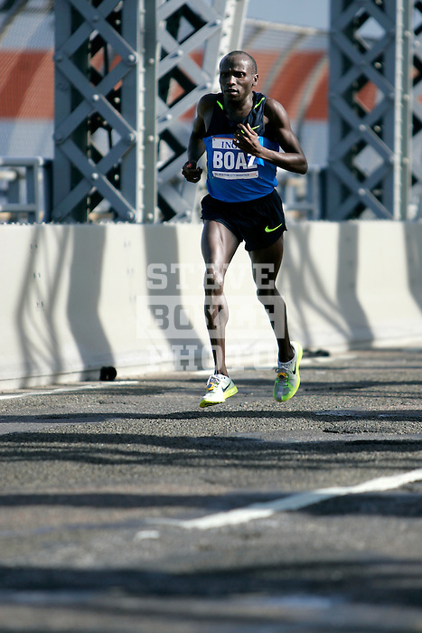 Boaz Cheboiywo (KEN) during the 2008 ING New York City Marathon on the Madison Avenue Bridge connecting the Bronx to Manhattan on November 2, 2008 in New York City, New York.  The racers enter Manhattan for the final time as they approach mile 21 on the course.  Gomes Dos Santos (BRA) won the race with a time of 2:0843.