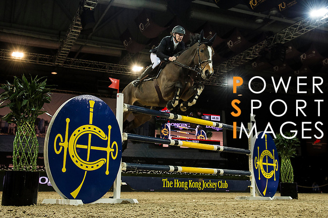 Roger-Yves Bost of France riding Nippon d'Elle  in action during the Hong Kong Jockey Club Trophy competition as part of the Longines Hong Kong Masters on 13 February 2015, at the Asia World Expo, outskirts Hong Kong, China. Photo by Victor Fraile / Power Sport Images