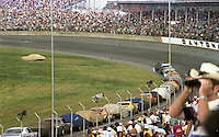 Cars and fans wait out a rain delay at the Firecracker 400 at Daytona International Speedway in Daytona Beach, Florida on July 4, 1977. (Photo by Brian Cleary/www.bcpix.com)