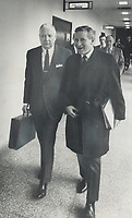 Can they solve the housing crisis? Carrying briefcase, federal Transport Minister Paul Hellyer and executive assistant Lloyd Axworthy (R) enter federal-provincial housing conference today. <br /> <br /> Photo : Boris Spremo - Toronto Star archives - AQP