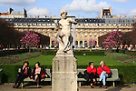 Visitors rest in the garden of Palais Royal. Paris. France