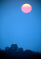 Sunset off the sea of Japan over the skyline of homes built in the style of traditional architecture. Japan.