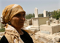 """Gaza.June.22.2008.Um yasser Khail 75 years old live in bad house in the cemetry ,Under  her house 3 graves """"The family was drove out from their original village in the 1948 when Jews forced thousands of Palestinians to migrate, establishing the State of Israe.June.22.2008l.""""photo by Fady Adwan/propaimages"""""""