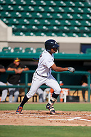 Detroit Tigers Jose Azocar (31) follows through on a swing during a Florida Instructional League game against the Pittsburgh Pirates on October 6, 2018 at Joker Marchant Stadium in Lakeland, Florida.  (Mike Janes/Four Seam Images)