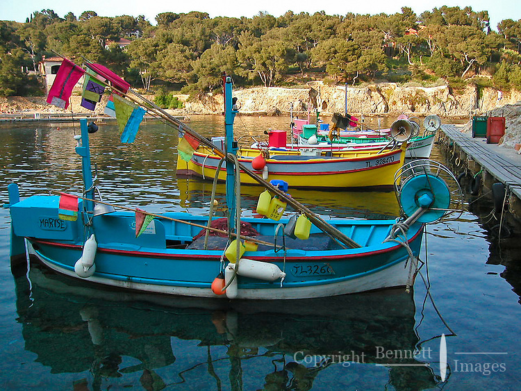 Brightly colored fishing boars are moored the harbor at Gien, in the Provence region of France.