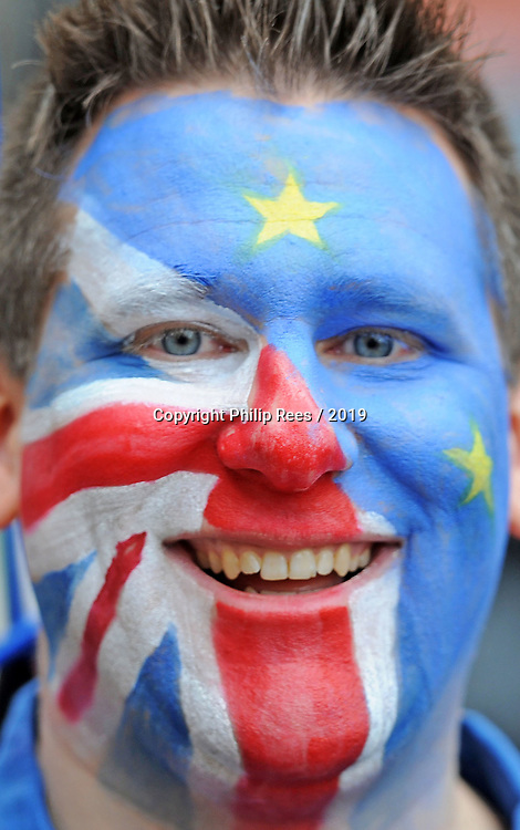 "A colourful protestor with British and European flags painted on his face during the ""Put it to the People"" rally which made it's way through central London today. Demonstrators from across the country gathered to call for a second referendum on Brexit and to march through the UK capital finishing with speeches in Parliament Square opposite the Houses of Parliament in Westminster."