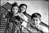 Three Bangladeshi children living in an unfit and overcrowded two-bedroom council flat in Levita House, King's Cross.