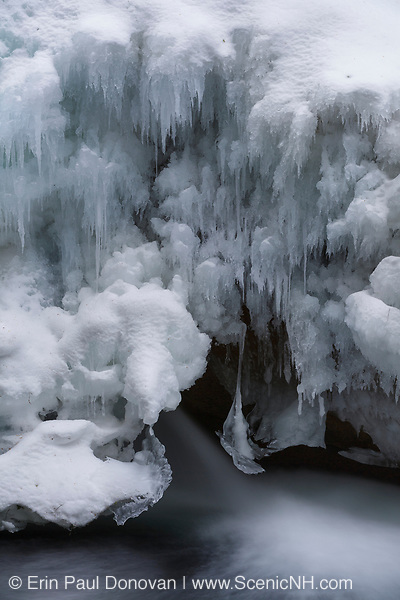 """The natural feature known as """"The Basin"""" along the Pemigewasset River in Franconia Notch State Park of Lincoln, New Hampshire during the winter months."""