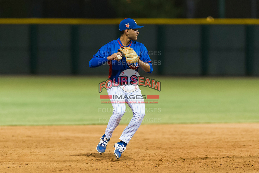 AZL Cubs 2 shortstop Miguel Pabon (13) prepares to make a throw to first base during an Arizona League game against the AZL Indians 2 at Sloan Park on August 2, 2018 in Mesa, Arizona. The AZL Indians 2 defeated the AZL Cubs 2 by a score of 9-8. (Zachary Lucy/Four Seam Images)