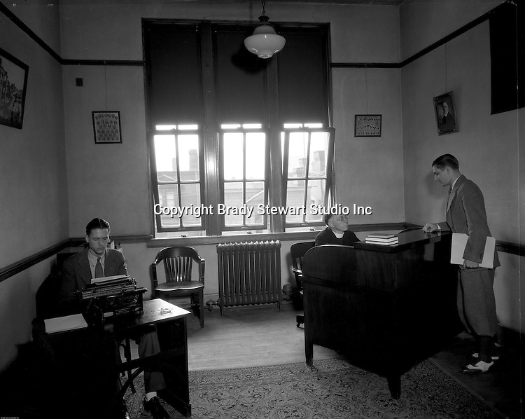 Pittsburgh PA: Student meeting with a College of the Arts professor, Duquesne University, and grad student typing a letter.<br /> Brady Stewart was hired to photography the campus, classrooms, and offices for a publication to increase enrollment at the Catholic University.
