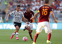 Calcio, Serie A: Roma vs Juventus. Roma, stadio Olimpico, 30 agosto 2015.<br /> Juventus' Paulo Dybala, left, is challenged by Roma's Seydou Keita during the Italian Serie A football match between Roma and Juventus at Rome's Olympic stadium, 30 August 2015.<br /> UPDATE IMAGES PRESS/Riccardo De Luca