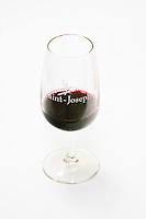 A red wine glass with Saint Joseph. Against a white background.  Domaine Eric et Joel Joël Durand, Ardeche, Ardèche, France, Europe